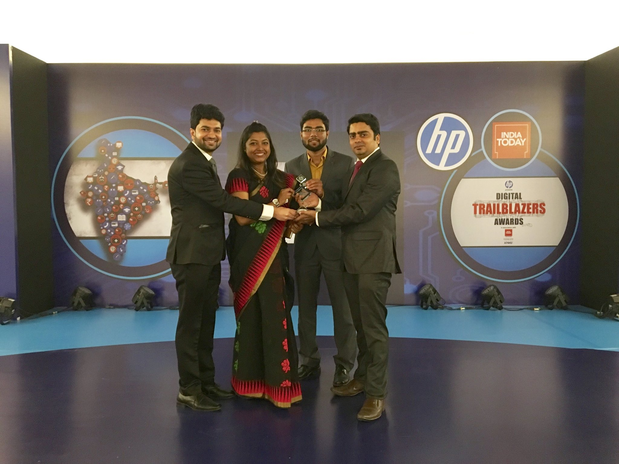 Form Left to Right - Gaurav, Rimi, Shaswat and Vaibhav Posing for Photo on the Stage at Digital TrailBlazers Award Ceremony